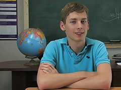 Twink pornstar Robbie Hart is sitting at a desk in a classroom and he's chatting all about his sexual experiences gay twinks in jock straps at Te
