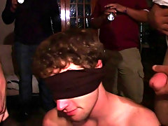 These frat boys had their pledge blind folded on his knees while two brothers one with a shirt that said fuck and the other with a shirt that said suc